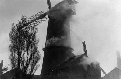 Fireman trying to save the mill 4th May 1913