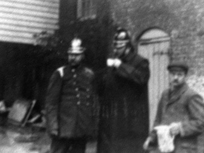 Firemen with miller Ephraim Witard providing drink