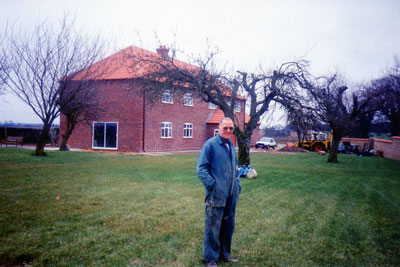 Ron Ashton in front of the new house c.1995