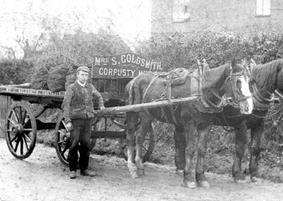Charles Pegg with Mrs Goldsmith's coal delivery cart c.1903