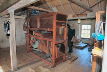 Mike Thurlow and the newly restored grain cleaner