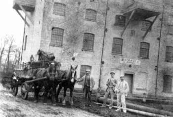 Workers outside the mill in 1910