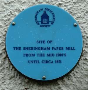 The plaque on the building said to occupy the site