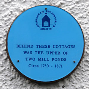 The plaque on a cottage in Beeston Road